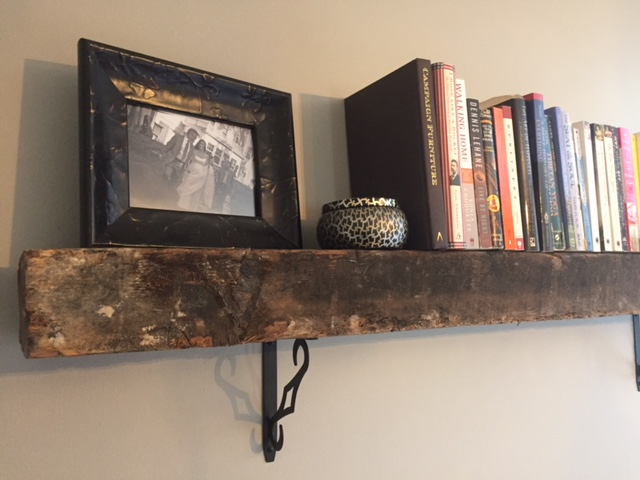 Reclaimed beam as book shelf